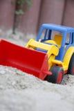 Het stuk speelgoed van kinderen, een graafwerktuig Stock Foto