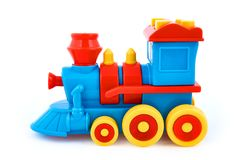 Het stuk speelgoed van plastic die kinderen locomotief op witte achtergrond wordt geïsoleerd royalty-vrije stock foto