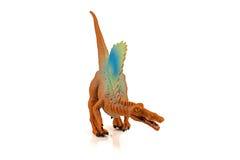 Het stuk speelgoed van Spinosaursdinosarus cijfer op witte achtergrond wordt geïsoleerd die Stock Foto's