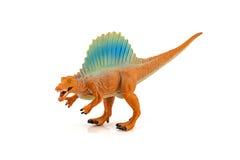 Het stuk speelgoed van Spinosaursdinosaurussen cijfer op witte achtergrond wordt geïsoleerd die Stock Foto's