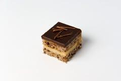 Het stuk van de chocolade van cake dat als kubus gestalte wordt gegeven Royalty-vrije Stock Foto's