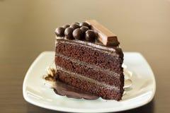 Het stuk van de close-upplak van donkere chocoladecake Stock Afbeelding