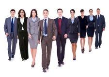Het succesvolle gelukkige commerciële team lopen stock foto
