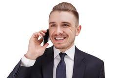 Het succesvolle het glimlachen bussinessman spreken op telefoon met zijn partner Royalty-vrije Stock Afbeeldingen