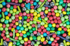 Het suikergoed bestrooit, op volledig-kaderachtergrond Mening van hierboven stock foto