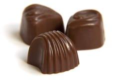 Het suikergoed van de chocolade op een witte achtergrond Stock Foto