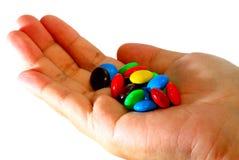 Het Suikergoed van de chocolade op Hand stock foto