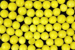 Het suikergoed van de citroen op een zwarte achtergrond Stock Afbeelding