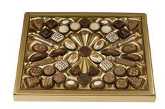 Het suikergoeddoos van de chocolade over wit met het knippen van weg. Royalty-vrije Stock Foto's