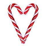 Het suikergoedriet van Kerstmis dat op witte achtergrond wordt geïsoleerdd Royalty-vrije Stock Afbeelding