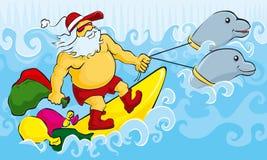 Het surfen Kerstman Stock Afbeeldingen