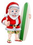 Het surfen Kerstman Stock Foto's
