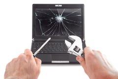 Het symbolische beeld van laptop reparatie Stock Fotografie