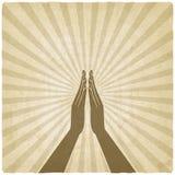 Het symbool oude achtergrond van gebedhanden Stock Foto