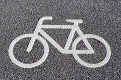 Het symbool van de fiets op asfalt Royalty-vrije Stock Afbeeldingen