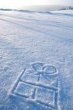 Het symbool van de gift in sneeuw Royalty-vrije Stock Foto