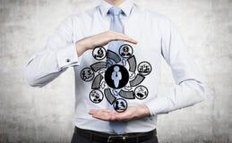 Het symbool van de zakenmanholding Stock Afbeeldingen