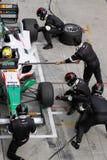 Het team Mexico tankt en verandert banden bij stock afbeelding