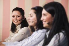 Het team van de de klantendienst van vrouwen Stock Foto's