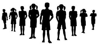 Het teamsilhouet van het kind Stock Foto