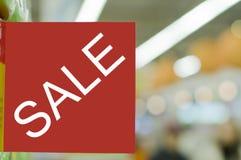 Het teken dat van de verkoop op een korting wijst Stock Afbeelding