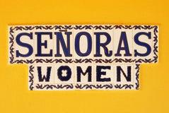 Het Teken het Spaans van het vrouwentoilet stock afbeelding