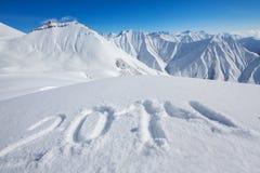 het teken van 2014 dat bij sneeuw wordt getrokken Stock Fotografie