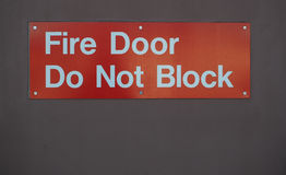 Het teken van de branddeur Stock Afbeelding