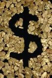 Het teken van de dollar in goudklompjes Stock Foto