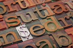 Het teken van de dollar in letterzetseltype Stock Foto's