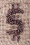 Het teken van de dollar van koffiebonen op jute Royalty-vrije Stock Fotografie