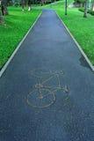 Het teken van de fiets liep met een groene kant Stock Foto's