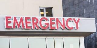 Het teken van de het ziekenhuisnoodsituatie op de ingang van ER Royalty-vrije Stock Fotografie