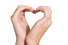 Het teken van de liefde, hart dat door vrouwelijke handen wordt gevormd Royalty-vrije Stock Afbeeldingen