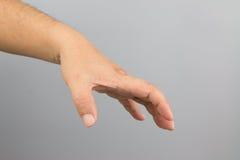Het teken van de mensenhand Stock Foto's
