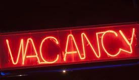 Het teken van de neonvacature voor motel stock afbeeldingen