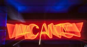 Het teken van de neonvacature voor motel stock afbeelding