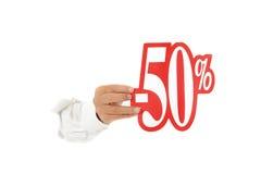 Het teken van de vijftig percentenkorting, hand. Stock Fotografie