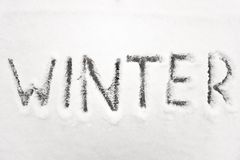 Het teken van de winter in sneeuw Stock Foto