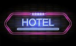 Het teken van het hotelneon op bakstenen muur Royalty-vrije Stock Afbeelding