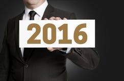 het teken van 2016 wordt gehouden door zakenmanconcept Stock Afbeelding