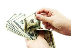 Het Tellen van dollars Stock Afbeeldingen