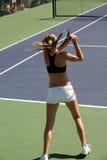 Het tennis van de vrouw stock afbeelding