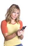 Het texting kijken van de vrouw stock afbeelding