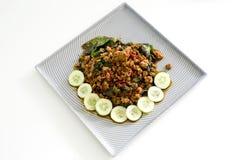 Het Thaise kruidige vlees van het voedselbasilicum braadde recept (Krapao Mooi) op vierkant Royalty-vrije Stock Afbeelding