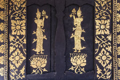 Het Thaise schilderen op de deur van de kerk Royalty-vrije Stock Foto's