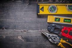 Het tin van de het staalsnijder van bouwniveaus knipt exemplaar Royalty-vrije Stock Foto's