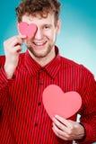 Het toejuichen van de harten van de mensenholding Stock Foto's