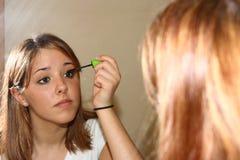 Het toepassen van make-up Stock Foto's