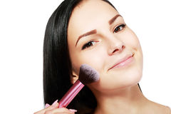Het toepassen van make-up stock afbeelding